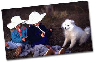 Kids in Fledgling Hat with puppy